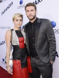 Liam Hemsworth and Miley Cyrus arrive on the red carpet at the premiere of Paranoia at the DGA Theatre on Aug. 8, 2013, in Los Angeles.