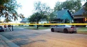 Police tape surrounds a car outside a Wichita, Kan., where a 10-month-old girl died.