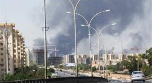 In this July 13 photo, smoke rises from the direction of Tripoli airport in Libya. Fighting among Libya militias prompted the US to evacuate its embassy in Tripoli.