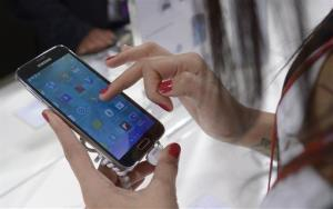 A new Samsung Galaxy S5 is displayed at the Mobile World Congress.