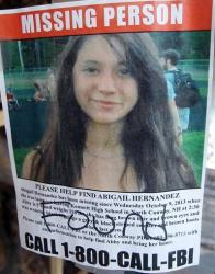 FILE - In this file photo taken Tuesday July 22, 2014, a missing person poster of Abigail Hernandez displayed in a storefront window in North Conway, N.H., shows Hernandez has been found. Hernandez, 15, returned home nine months after vanishing on her way home from high school. But the...