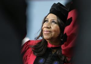 In a May 29, 2014 photo, Aretha Franklin looks up while on stage during Harvard University commencement ceremonies, in Cambridge, Mass., where she was presented with an honorary Doctor of Arts degree.