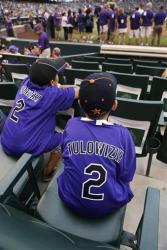 Young fans wear misspelled jerseys with the name of Colorado Rockies All-Star shortstop Troy Tulowitzki in Denver, Saturday, July 26, 2014.