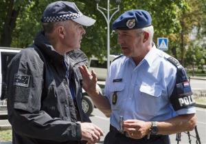 Dutch, right, and Australian policemen talk in the city of Donetsk, eastern Ukraine yesterday.