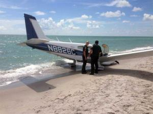 This photo provided by the Sarasota County Sheriff's Office shows emergency personnel at the scene of a small plane crash in Caspersen Beach in Venice, Florida.