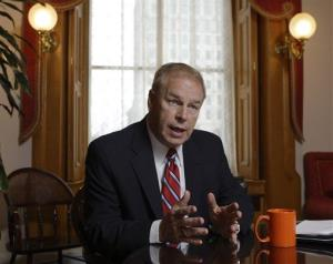 In this Dec. 20, 2010 file photo, Ohio Gov. Ted Strickland answers questions during an interview in Columbus, Ohio.