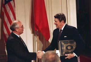 In this Dec. 8, 1987, photo, Ronald Reagan shakes hands with Soviet leader Mikhail Gorbachev after the two leaders signed the Intermediate-Range Nuclear Forces Treaty.