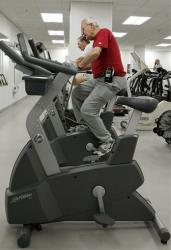 A cardiac patient rides an exercise bike at the Cleveland Clinic in this file photo.