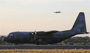 File photo of a C-130 sitting on an airport tarmac.