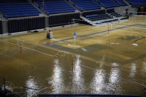 At least an inch of water covers the playing floor at Pauley Pavilion, home of UCLA basketball, after a broken 30-inch water main under nearby Sunset Boulevard caused flooding yesterday.