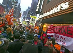 Demonstrators rally for better wages outside a McDonald's restaurant in New York as part of a national protest last December.