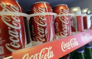 In this June 30, 2014 photo cans of Coca-Cola soda pop are shown in the refrigerator inside of Chile Lindo in San Francisco.