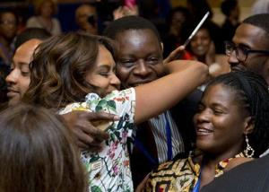 First lady Michelle Obama hugs a participant of the DC summit of young African leaders.