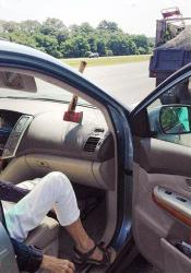 An ax head rests on a car's dashboard with the handle stuck in the windshield on Route 95 in Topsfield, Mass.
