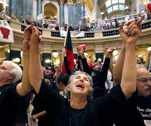 In this Aug. 25, 2011 file photo Mary Kay Baum joins hundreds of labor union members at a rally to protest the collective bargaining measures of Wisconsin Governor Scott Walker's administration.