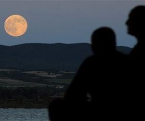 A perigee moon also known as a supermoon rises above Dojran Lake in southeastern Macedonia, Saturday, July 12, 2014.