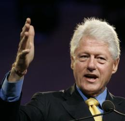 Former President Bill Clinton gestures while delivering the keynote speech at the 16th Telugu Association of North America conference.