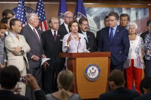 Nancy Pelosi, accompanied by member of the Congressional Hispanic Caucus and Democratic leaders, speaks during a news conference on Capitol Hill in Washington, Friday, Aug. 1, 2014.