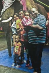In this undated family file photo, Eric Garner, right, poses with his children during a family outing.
