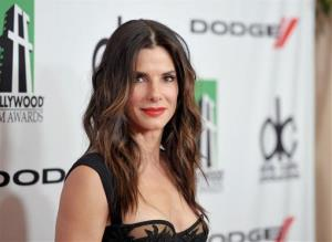In this Oct. 21, 2013 file photo, Sandra Bullock arrives at the 17th Annual Hollywood Film Awards Gala at the Beverly Hilton Hotel in Beverly Hills, Calif.
