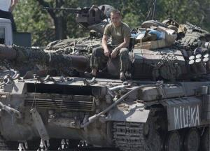 A Ukrainian government army soldier rests on his tank at a block-post in the village of Debaltseve, eastern Ukraine Friday, Aug. 1, 2014.