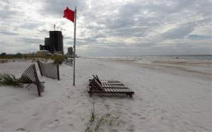 An empty beach is shown in Orange Beach, Ala.