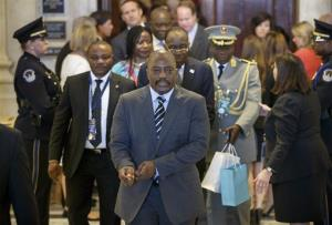 President of the Democratic Republic of Congo Joseph Kabila, center, departs a reception for leaders attending the US-Africa Summit on Capitol Hill in Washington, Monday, Aug. 4, 2014.