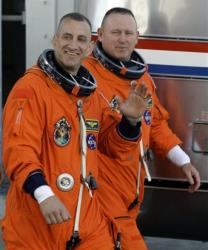 In this file photo, space shuttle Atlantis commander Charles Hobaugh, left, and pilot Barry Wilmore are seen.