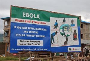 A public information board explains the symptoms of the deadly Ebola virus in the city of  Freetown, Sierra Leone.
