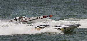 Boats navigate a turn during the first heat of the Atlantic City Offshore Grand Prix powerboat races in Atlantic City, N.J., Sunday,  June 22, 2014.