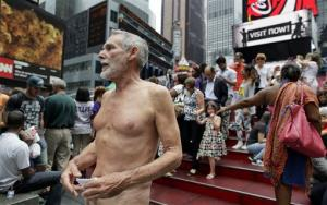 George Davis, a candidate for the San Francisco Board of Supervisors, makes a speech in the nude on Times Square Wednesday.