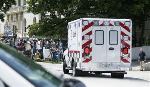 An ambulance transporting Nancy Writebol arrives at Emory University Hospital Tuesday in Atlanta.