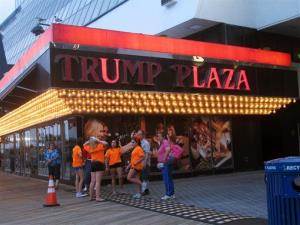 This July 24, 2014 photo shows several lights burned out in the illuminated facade of the Trump Plaza Hotel Casino in Atlantic City, NJ.