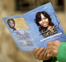 Karen Powell, aunt of Renisha McBride, holds a program at her funeral in this file photo.