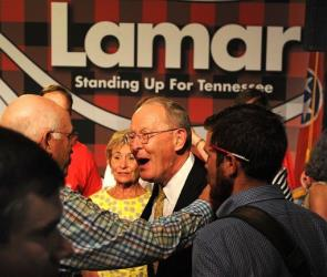 Sen. Lamar Alexander celebrates after defeating state Rep. Joe Carr yesterday.