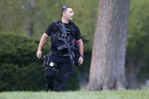 A member of the US Secret Service Emergency Response Team (ERT) stands watch on the North Lawn at the White House yesterday.