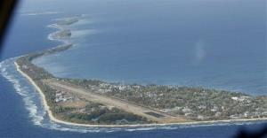 In this Oct. 13, 2011 photo, Funafuti, the main island of the nation state of Tuvalu, is seen from a Royal New Zealand airforce C130 aircraft as it approaches at Funafuti, Tuvalu, South Pacific.