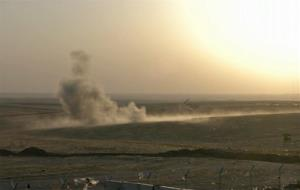 This image made from AP video shows smoke rising from airstrikes targeting Islamic State militants near the Khazer checkpoint outside of the city of Irbil in northern Iraq, Friday, Aug. 8, 2014.