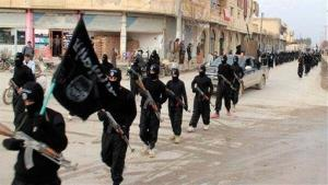 FILE - This undated file image posted on a militant website on Tuesday, Jan. 14, 2014, which has been verified and is consistent with other AP reporting, shows fighters from the al-Qaida linked Islamic State of Iraq and the Levant (ISIL) marching in Raqqa, Syria. Across the broad swath of...