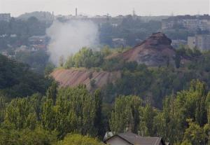 Smoke from shelling rises over a residential neighborhood in Donetsk yesterday.