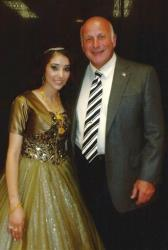 In this 2013 photo downloaded from the Yonkers Police Department Facebook page, Shammarah Hamideh poses with Yonkers Police Capt. Joseph Barca at her engagement party.