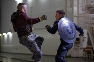 This image released by Marvel shows George St-Pierre, left, and Chris Evans in a scene from Captain America: The Winter Soldier.