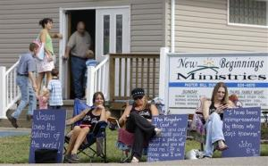 An older protest by supporters of the Foxhole club outside the New Beginnings Ministries Church in Warsaw, Ohio, this one on Aug. 22, 2010.