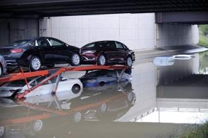 A car carrier is stranded along a flooded stretch of I-696 at the Warren, Mich., city limits Tuesday morning, Aug. 12, 2014.