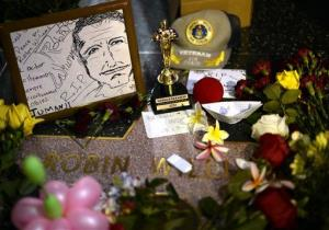 Flowers are placed in memory Robin Williams' Walk of Fame star in the Hollywood district of Los Angeles.