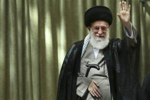Supreme Leader Ayatollah Ali Khamenei waves to a crowd just outside Tehran, Iran, Wednesday, June 4, 2014.