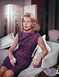 This 1965 file photo shows actress Lauren Bacall at her home in New York.