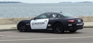 A Maserati resembling a police cruiser sits parked along the shore in Quincy, Mass.