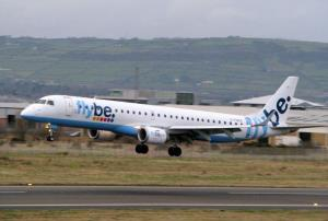 A Flybe plane lands at Belfast City Airport.