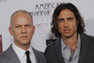 Ryan Murphy, left, and Brad Falchuk, co-creators of the television series American Horror Story: Asylum, pose together at the premiere at Paramount Theatre on Oct. 13, 2012, in Los Angeles.